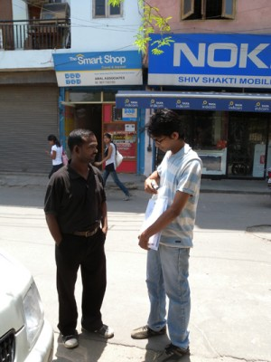 Rahul and the driver discussing where to go